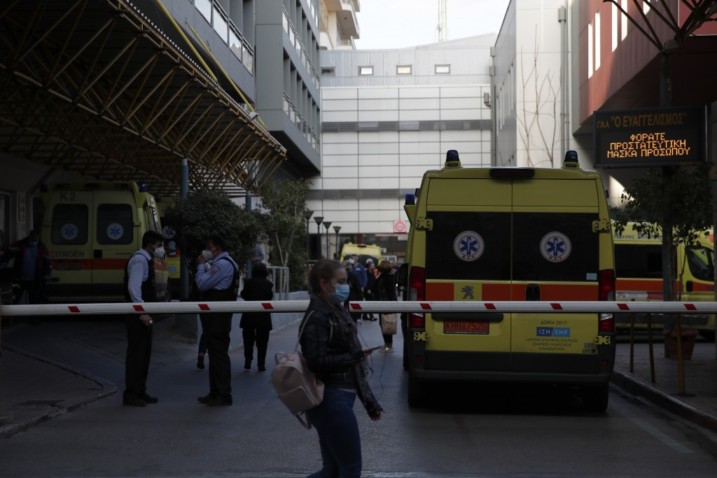 Ambulances are parked at Evangelismos hospital, one of the main public hospital used for treatment of coronavirus cases in Athens, Tuesday, April 6, 2...
