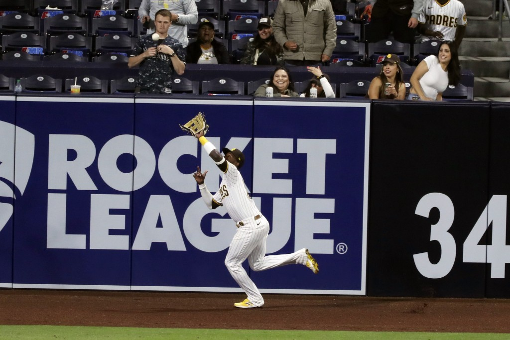 San Diego Padres left fielder Jurickson Profar makes a catch on the warning track against the San Francisco Giants in the fourth inning of a baseball ...