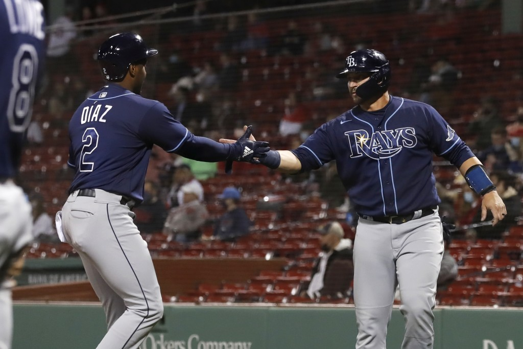 Tampa Bay Rays' Yandy Díaz (2) and Mike Zunino celebrate after scoring on a single by Manuel Margot during the third inning of the team's baseball gam...