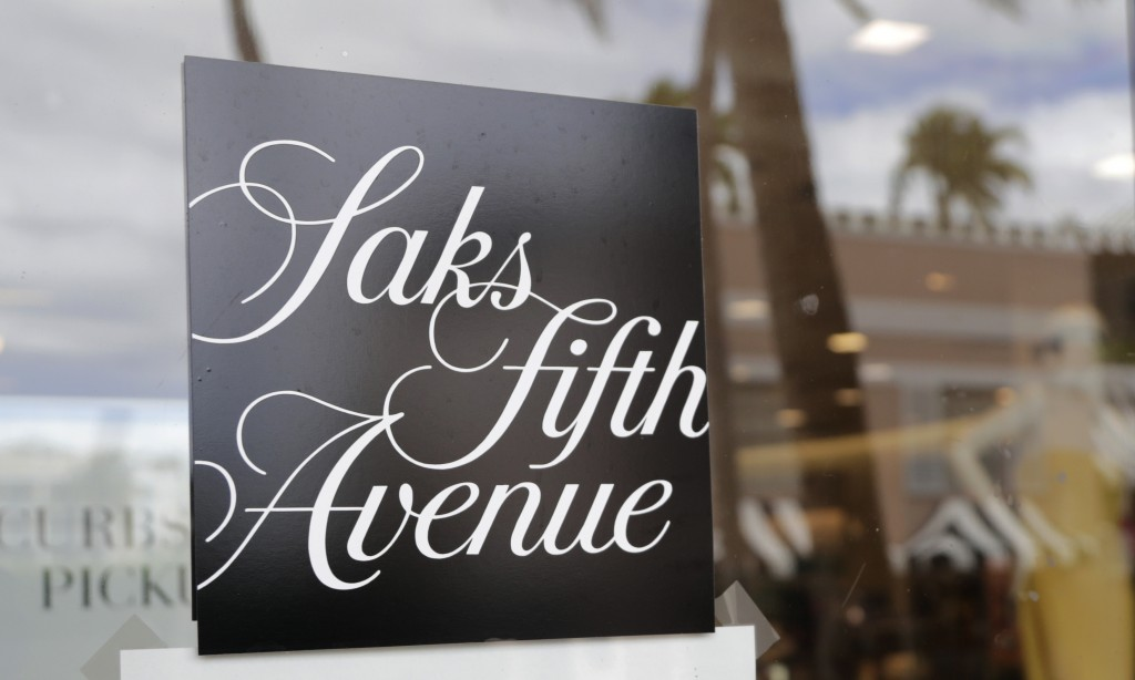 FILE - In this May 11, 2020 file photo, a Saks Fifth Avenue store remains closed on Worth Ave. during the new coronavirus pandemic in Palm Beach, Fla....