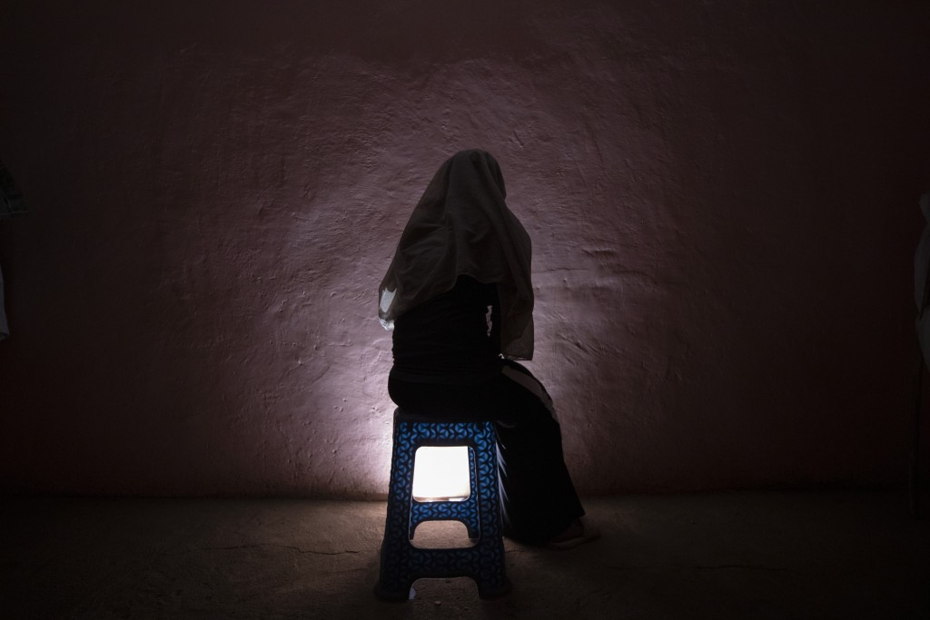 A Tigrayan refugee rape victim who fled the conflict in Ethiopia's Tigray sits for a portrait in eastern Sudan near the Sudan-Ethiopia border, on Marc...