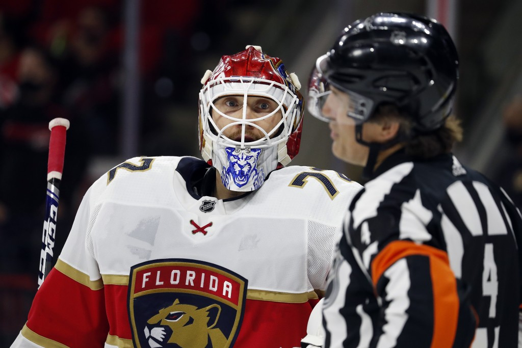 Florida Panthers goaltender Sergei Bobrovsky (72) speaks with an official during a timeout in the second period of an NHL hockey game against the Caro...