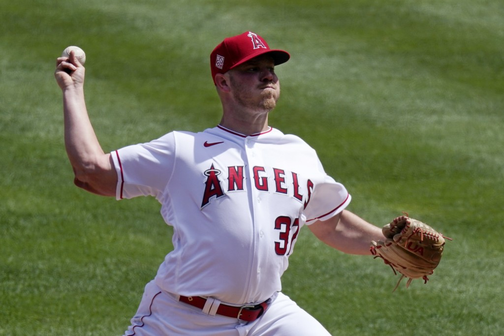 Los Angeles Angels starting pitcher Dylan Bundy throws to the plate during the first inning of a baseball game against the Houston Astros Tuesday, Apr...