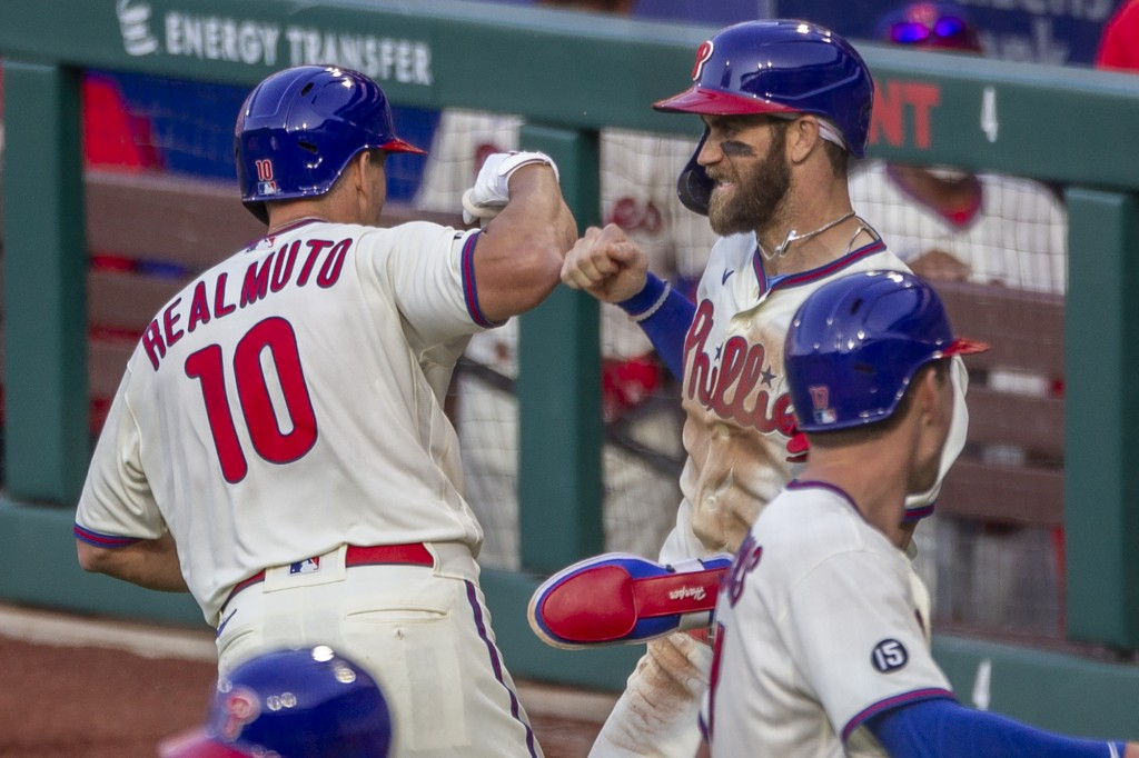 Philadelphia Phillies J.T. Realmuto (10) is congratulated by Bryce Harper after hitting a three run homer during the fifth inning of a baseball game a...