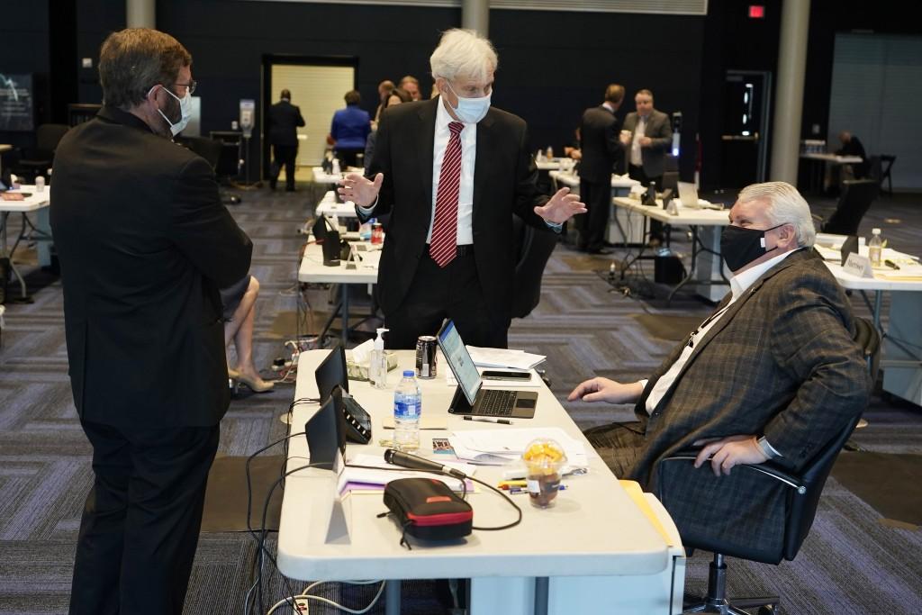 Virginia State Senate Majority Leader, Sen. Richard Saslaw, center, along with Sen. John Cosgrove, R-Chesapeake, left, talk with new Sen. Travis Hackw...