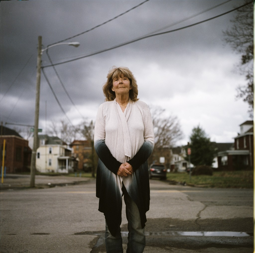 In this photo made with a medium format film camera, Sue Howland, a member of the Quick Response Team that tries to track down everyone who overdoses ...