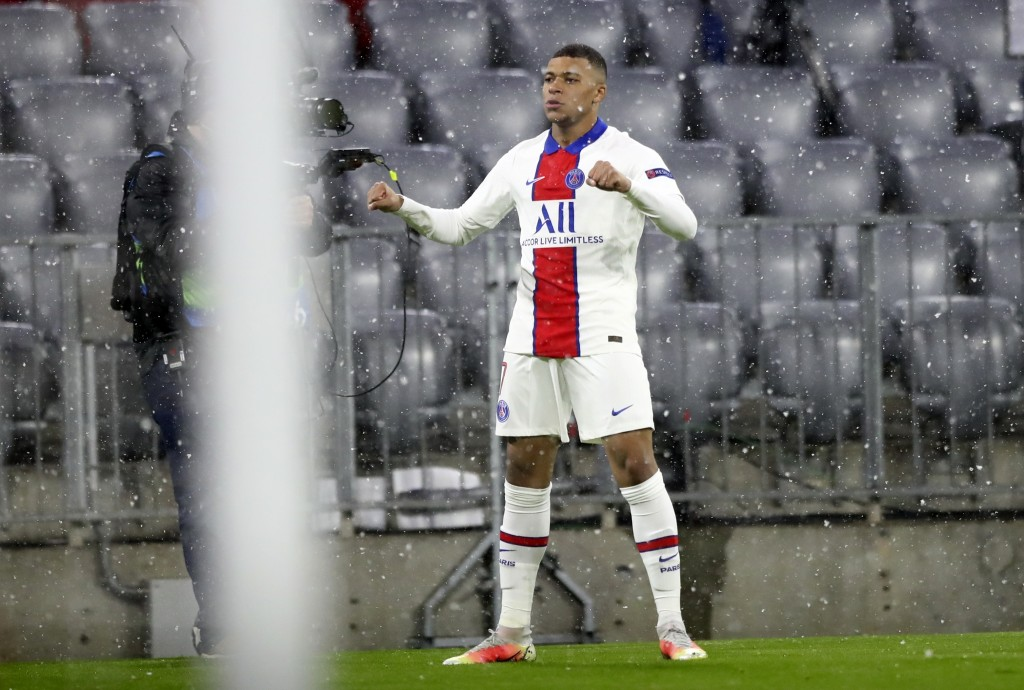 PSG's Kylian Mbappe celebrates after scoring the opening goal of his team during the Champions League quarterfinal soccer match between Bayern Munich ...