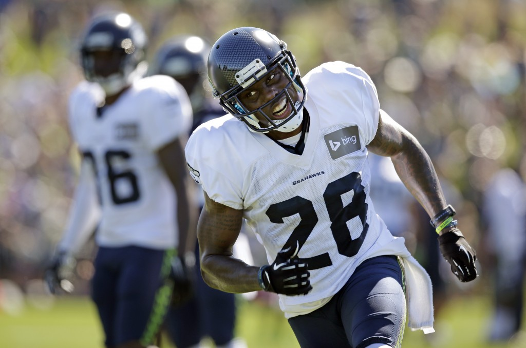 FILE - In this July 30, 2014 file photo, Seattle Seahawks' Phillip Adams runs during an NFL football camp practice in Renton, Wash. A source briefed o...