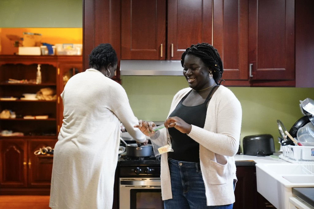 Ebele Azikiwe, 12, right, cooks with her mother, Rume Joy Azikiwe-Oyeyemi, at home in Cherry Hill, N.J., Wednesday, March 24, 2021. Ebele testified in...