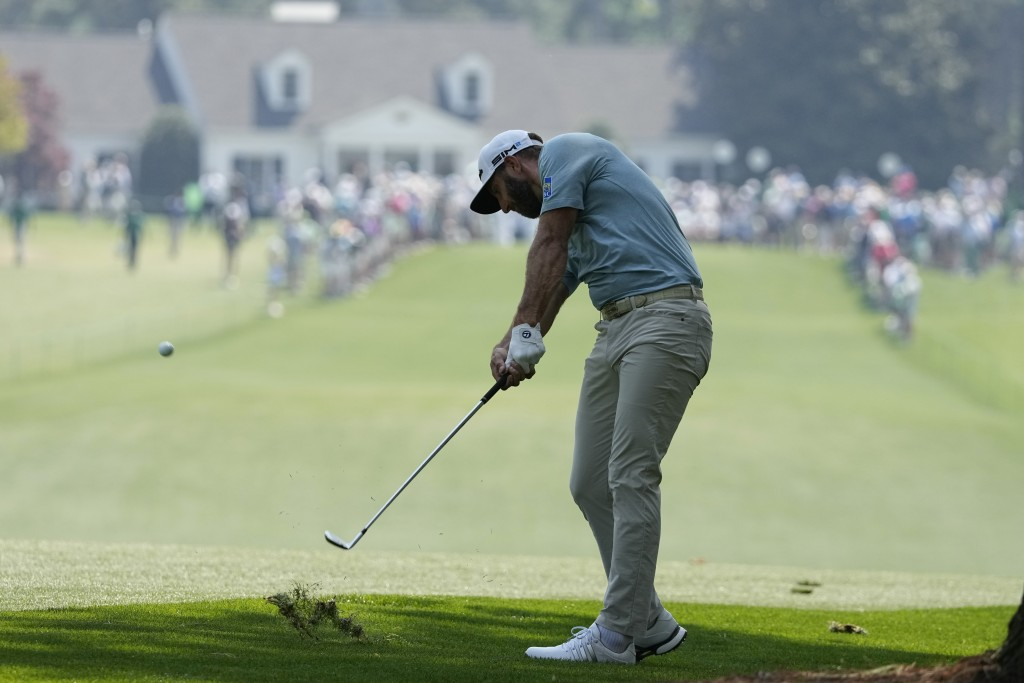 Dustin Johnson hits on the first fairway during a practice round for the Masters golf tournament on Wednesday, April 7, 2021, in Augusta, Ga. (AP Phot...