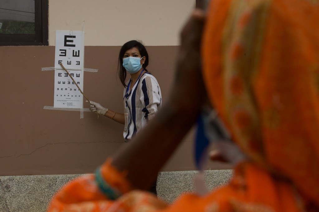 A patient gets her eye checked during her follow up after her cataract surgery at an eye camp in Lumbini, 288 kilometers (180 miles) south west of Kat...