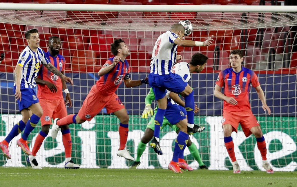 Porto's Pepe, centre, heads the ball during the Champions League, first leg, quarterfinal soccer match between FC Porto and Chelsea at the Ramon Sanch...