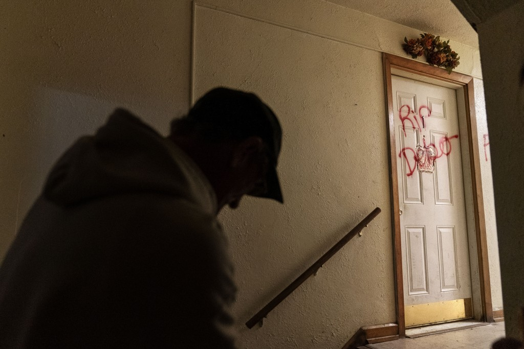 "The message ""RIP Debo"" is spray painted on the apartment door that had been the home of 41-year-old Debbie Barnette, a mother of three, in Huntington,..."