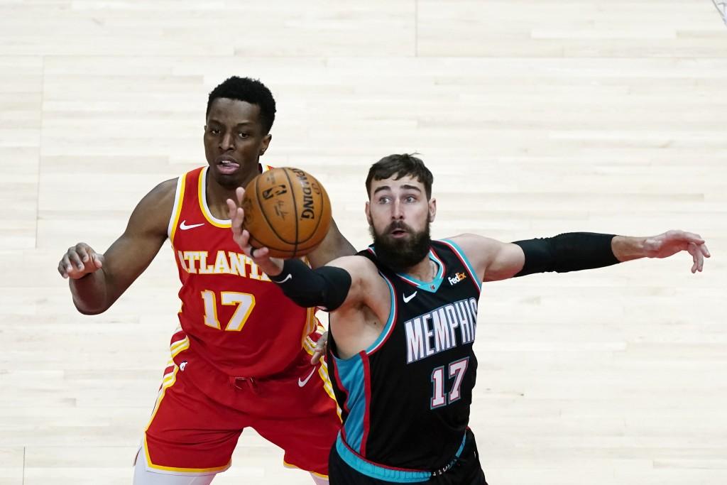 Memphis Grizzlies center Jonas Valanciunas (17) grabs a rebound in front of Atlanta Hawks forward Onyeka Okongwu (17) in the first half of an NBA bask...