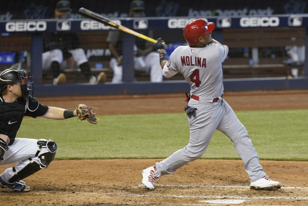 St. Louis Cardinals' Yadier Molina (4) hits a home run in the seventh inning of a baseball game against the Miami Marlins, Wednesday, April 7, 2021, i...