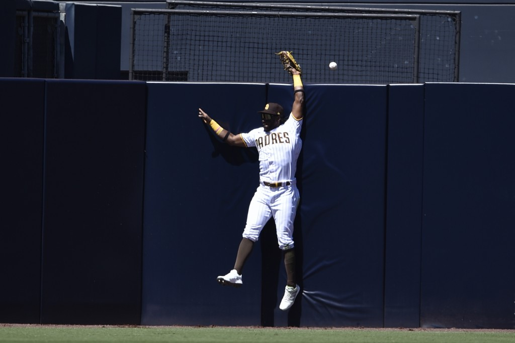 San Diego Padres center fielder Jorge Mateo is unable to make a catch for a two-run home run by San Francisco Giants' Darin Ruf during the second inni...