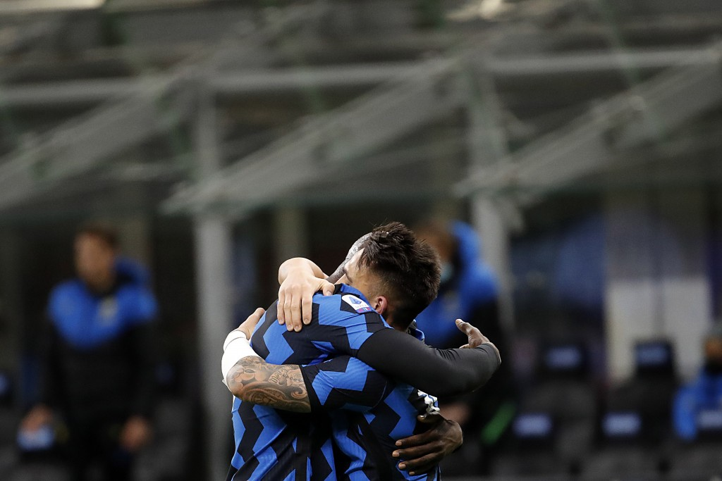 Inter Milan's Lautaro Martinez, right, celebrates with his teammate Romelu Lukaku after scores against Sassuolo during the Serie A soccer match betwee...