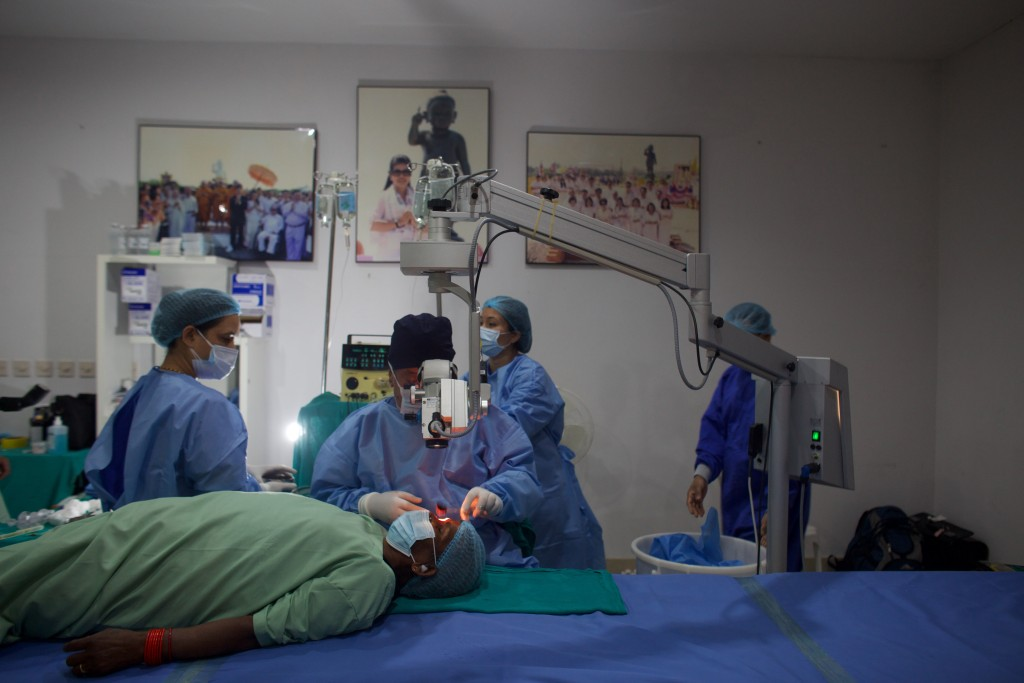 """Nepal's """"God of Sight"""", Dr. Sanduk Ruit performs a simple surgical technique to remove cataracts at an eye camp in Lumbini, 288 kilometers (180 miles)..."""