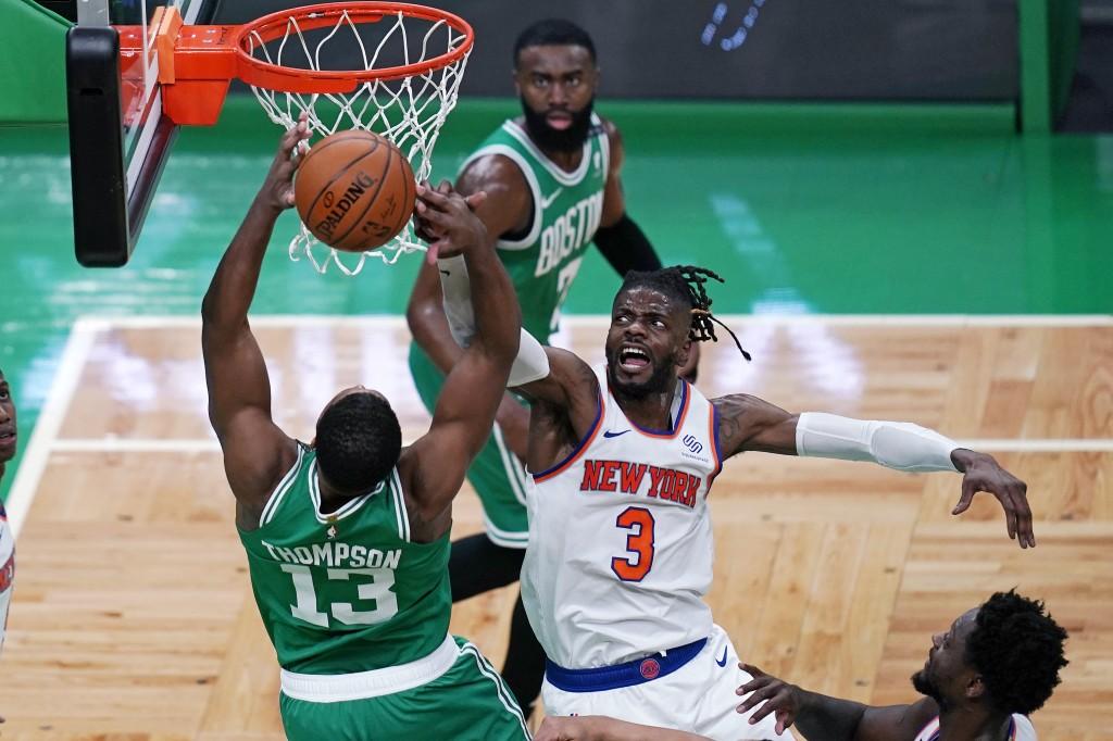 New York Knicks center Nerlens Noel (3) blocks a shot by Boston Celtics center Tristan Thompson (13) during the first half of an NBA basketball game W...