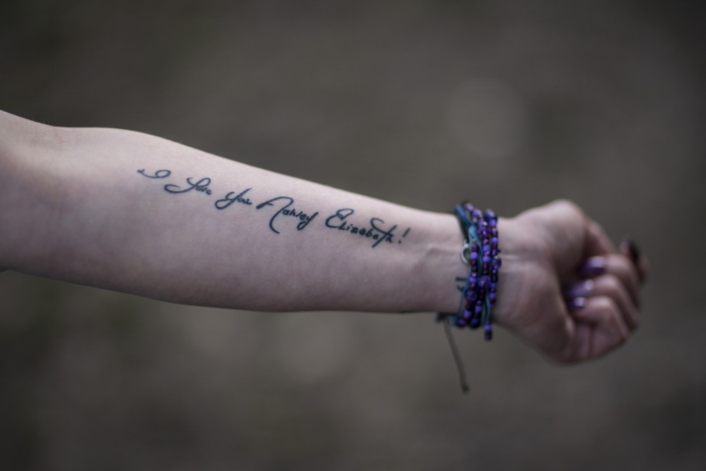 Ashley Ellis, 34, shows a tattoo of a handwritten note from her fiancé, Brandon Williams, on her arm, Tuesday, March 16, 2021, in Huntington, W.Va. El...