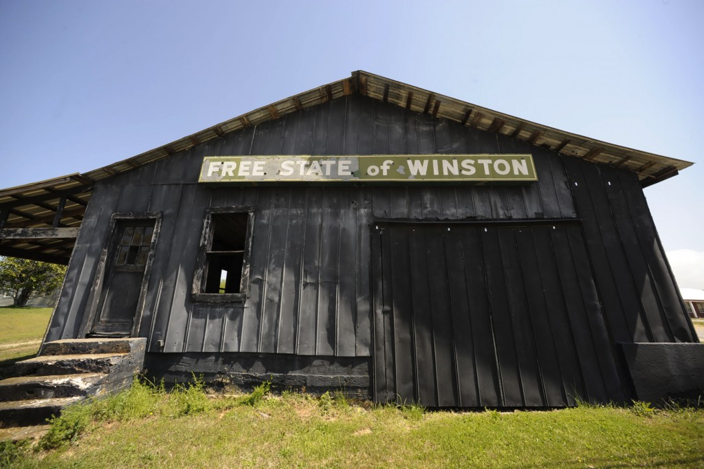 An abandoned building adorned with the age-old nickname of Winston County, stands near Double Springs, Ala., Monday, April 5, 2021. The county, which ...