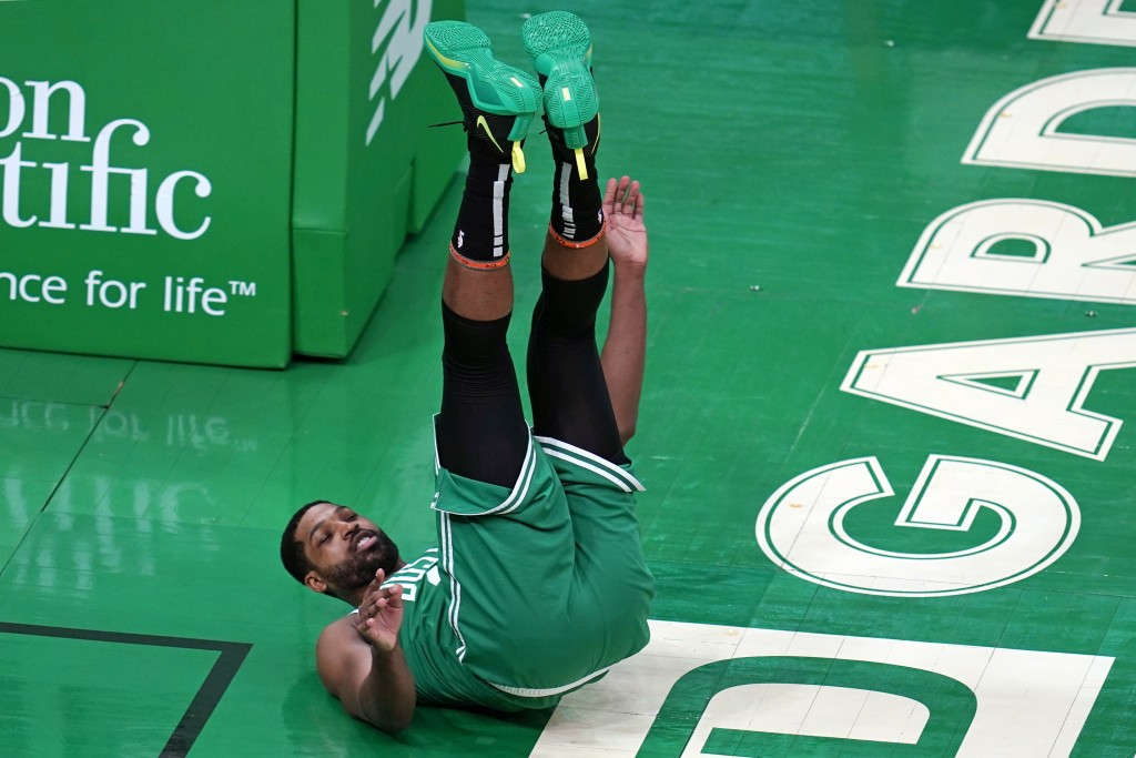 Boston Celtics center Tristan Thompson (13) is upended after block by New York Knicks center Nerlens Noel during the first half of an NBA basketball g...