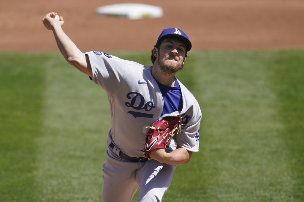 Los Angeles Dodgers pitcher Trevor Bauer throws against the Oakland Athletics during the first inning of a baseball game in Oakland, Calif., Wednesday...
