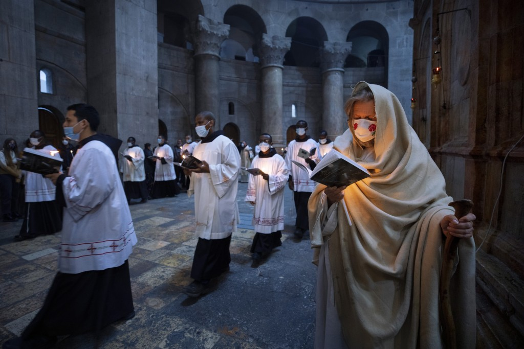 Priests circle the Edicule during Easter Sunday Mass led by the Latin Patriarch at the Church of the Holy Sepulchre, traditionally where many Christia...