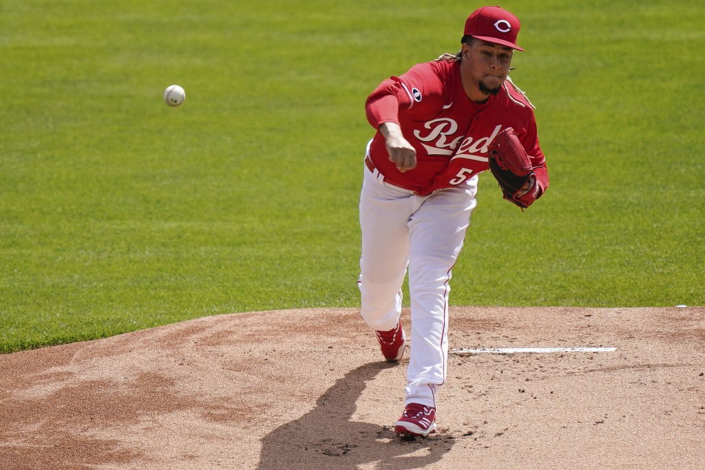 Cincinnati Reds' starting pitcher Luis Castillo (58) pitches in the first inning of a baseball game against the Pittsburgh Pirate at Great American Ba...