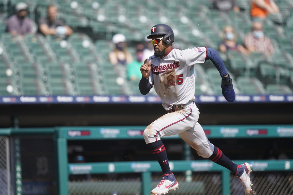 Minnesota Twins' Byron Buxton runs home to score on teammate Willians Astudillo's sacrifice fly to right during the fifth inning of a baseball game ag...
