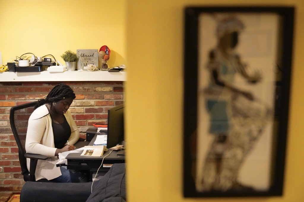 Ebele Azikiwe, 12, writes at her desk at home in Cherry Hill, N.J., Wednesday, March 24, 2021. Azikiwe testified in October at a state Assembly hearin...
