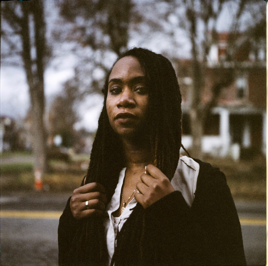 In this photo made with a medium format film camera, Larrecsa Cox, 39, stands for a portrait in Huntington, W.Va., Thursday, March 18, 2021. Cox, a pa...