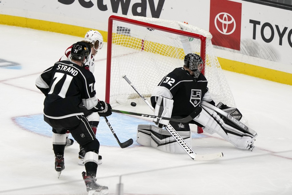 Los Angeles Kings goaltender Jonathan Quick (32) gives up a goal on a shot from Arizona Coyotes' Ilya Lyubushkin, not seen, during the first period of...