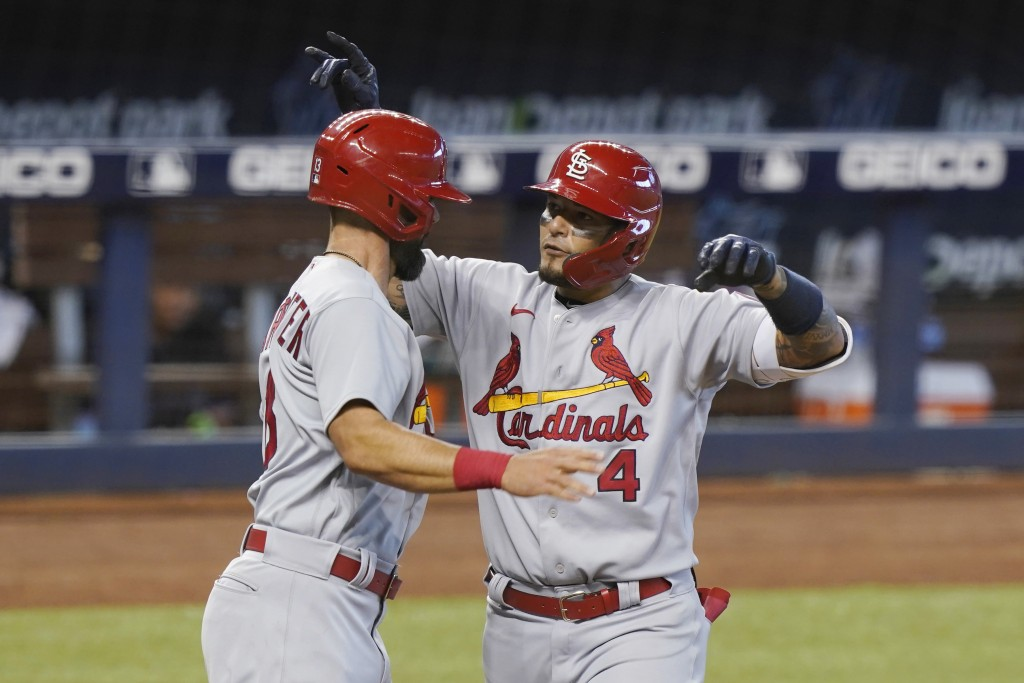 St. Louis Cardinals designated hitter Matt Carpenter (13) congratulates Yadier Molina (4) after Molina hit a home run in the seventh inning of a baseb...