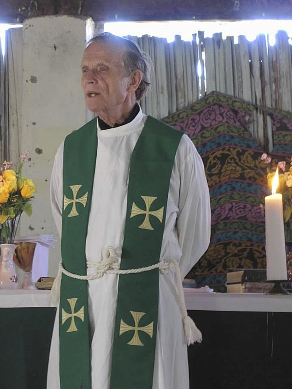 This 2013 photo provided to The Associated Press shows now-defrocked Catholic priest Richard Daschbach leading a service at a church in Kutet, East Ti...