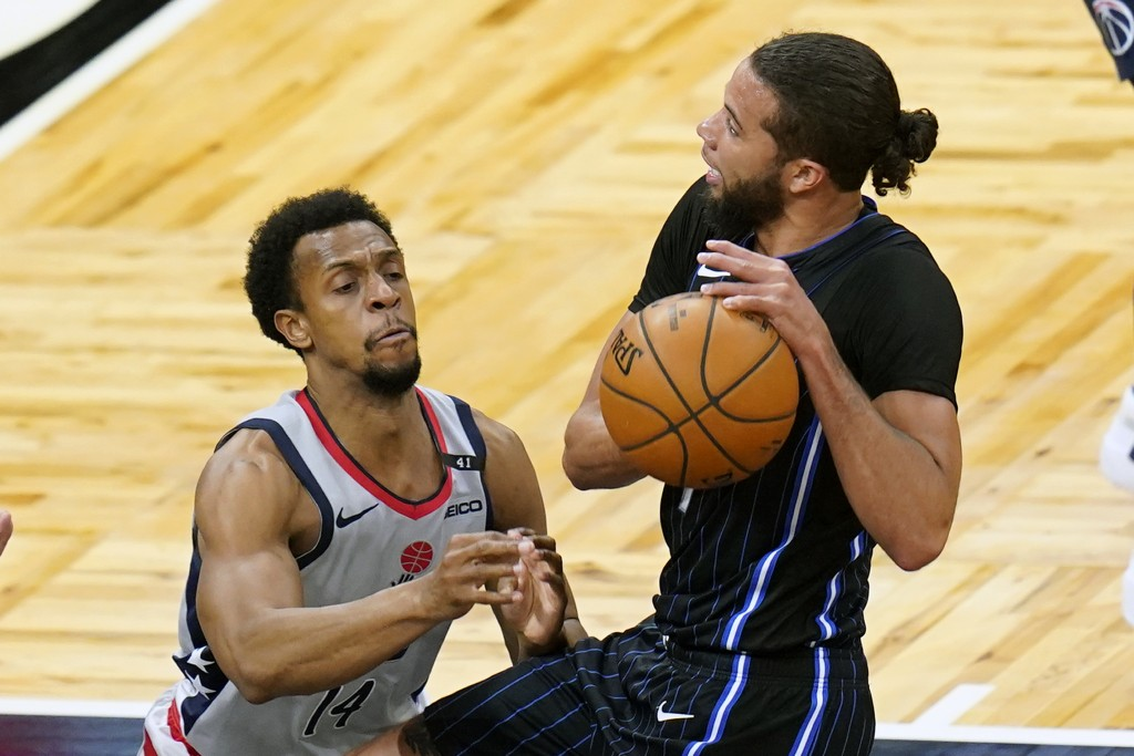 Washington Wizards guard Ish Smith, left, tries to stop Orlando Magic guard Michael Carter-Williams from shooting during the first half of an NBA bask...