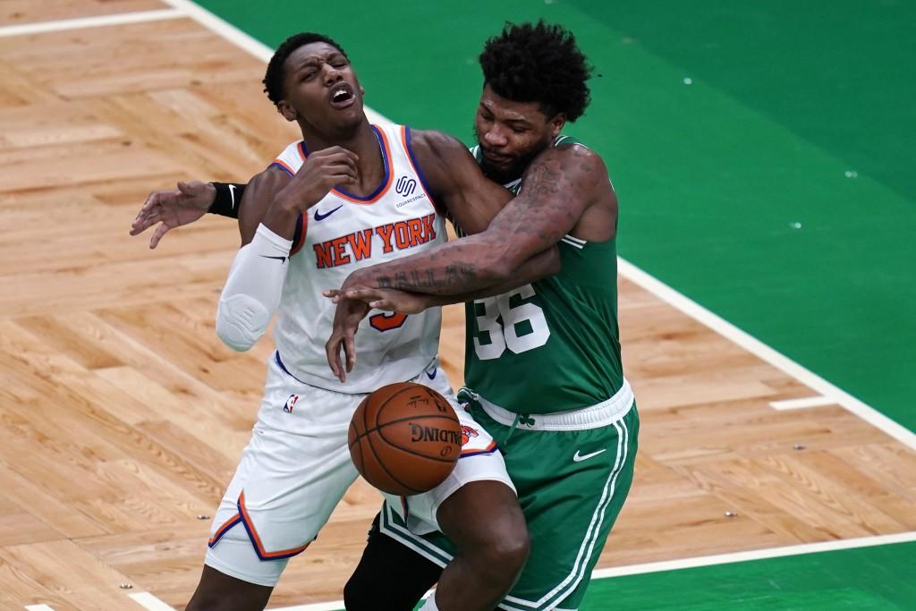Boston Celtics guard Marcus Smart (36) fouls New York Knicks guard RJ Barrett, left, during the first half of an NBA basketball game Wednesday, April ...