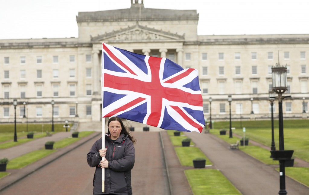 A Loyalist protester opposed to the Northern Ireland Protocol on Brexit makes a political point outside parliament buildings, Stormont, Belfast, North...