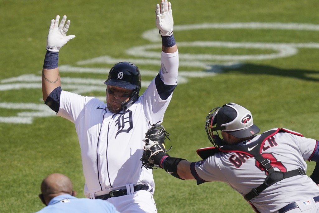 Detroit Tigers' Miguel Cabrera is tagged out by Minnesota Twins catcher Mitch Garver (8) as he tries to score from third during the sixth inning of a ...