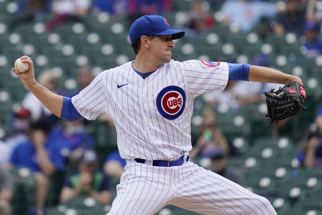 Chicago Cubs starting pitcher Kyle Hendricks throws against the Milwaukee Brewers during the first inning of a baseball game in Chicago, Wednesday, Ap...