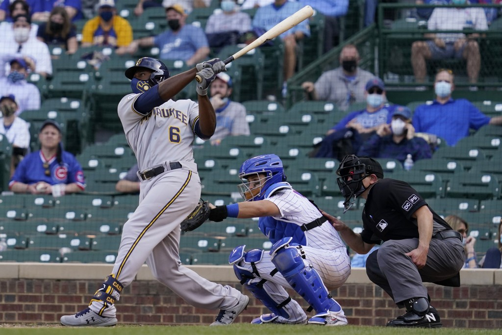 Milwaukee Brewers' Lorenzo Cain hits a three-run home run against the Chicago Cubs during the 10th inning of a baseball game in Chicago, Wednesday, Ap...