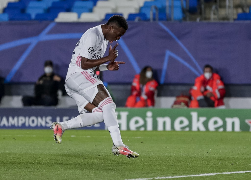 FILE - In this file photo dated Tuesday, April 6, 2021, Real Madrid's Vinicius Junior celebrates after scoring his second goal during the Champions Le...