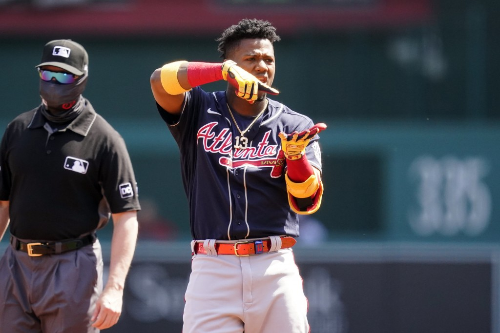 Atlanta Braves' Ronald Acuna Jr. celebrates his double during the first inning in the first baseball game of a doubleheader against the Washington Nat...