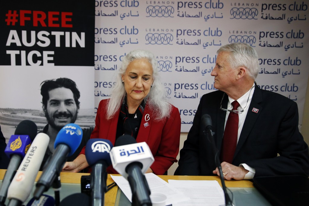 FILE - In this Dec. 4, 2018, file photo Marc and Debra Tice, the parents of Austin Tice, who is missing in Syria, speak during a press conference, at ...