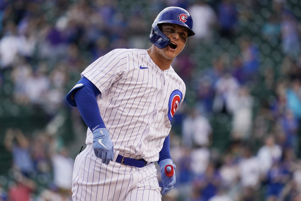 Chicago Cubs' Joc Pederson reacts as he rounds the bases after hitting a solo home run during the eighth inning of a baseball game against the Milwauk...