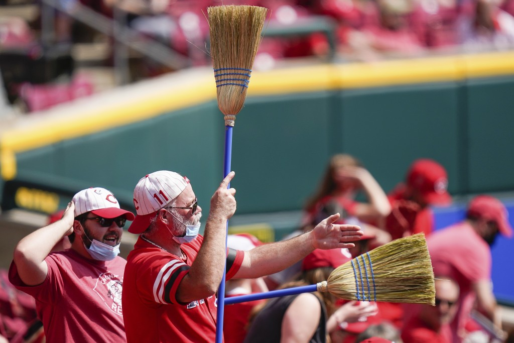 Cincinnati Reds' fans celebrate during the eighth inning of a baseball game against the Pittsburgh Pirates at Great American Ball Park in Cincinnati, ...