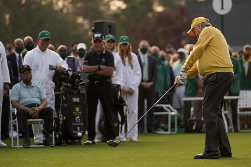 Lee Elder and Gary Player watch as Jack Nicklaus hits the ceremonial first tee during the first round of the Masters golf tournament on Thursday, Apri...