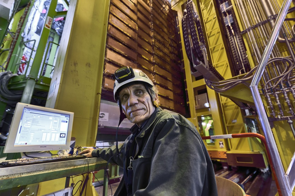 In this 2018 photo made available by CERN, Nikolai Bondar works on the LHCb Muon system at the European Organization for Nuclear Research Large Hadron...