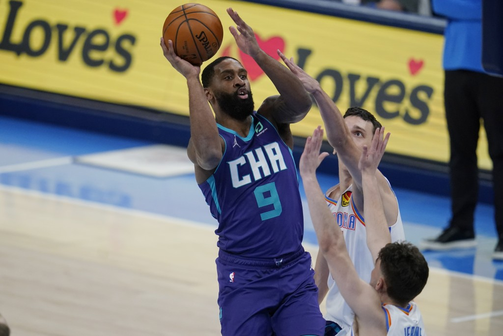 Charlotte Hornets guard Brad Wanamaker (9) shoots over Oklahoma City Thunder guard Ty Jerome, right, in the second half of an NBA basketball game Wedn...