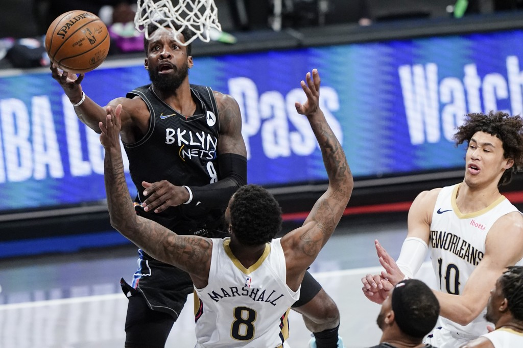 Brooklyn Nets' Jeff Green (8) shoots over New Orleans Pelicans' Naji Marshall (8) as Jaxson Hayes (10) reacts during the first half of an NBA basketba...